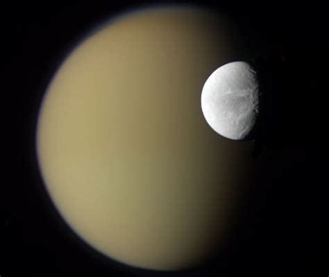 APOD: 2010 April 20 - Saturn's Moons Dione and Titan from