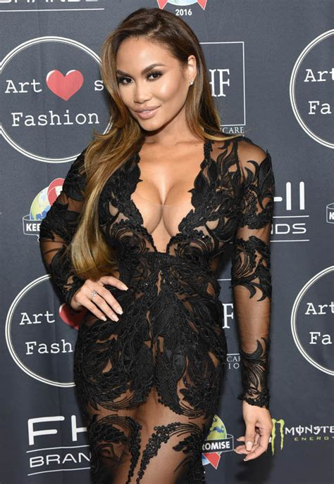 Daphne Joy's boobs dominate plunging see-through gown