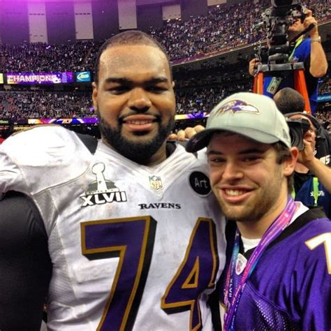 Baltimore Ravens offensive tackle Michael Oher (left) and